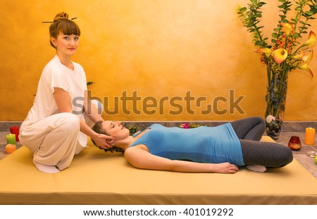 Women practicing physical energy flexibility exercise indoor - stock photo