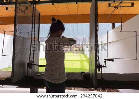 Women rifle shooting in the indoor Shooting Range.