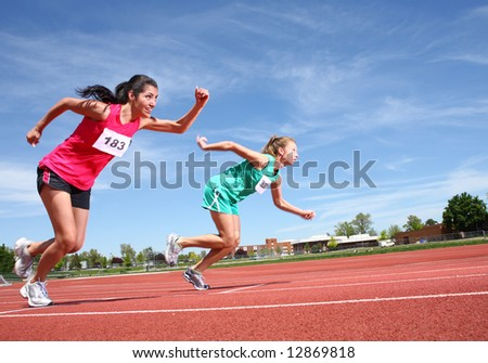 Women running on track - stock photo
