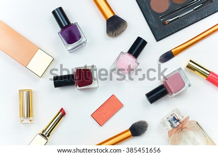 Women's accessories. Still life of fashion women. Scattered accessories: nail polish, perfume, lipstick, foundation. Overhead of essentials fashion woman objects. Top view - stock photo