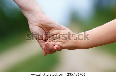Women's and children's hands - stock photo