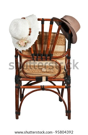 women's and men's hat on the back of the chair isolated on white background