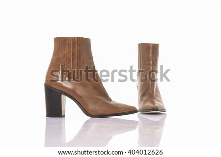Women's autumn ankle boots black zip average heels, isolated - stock photo