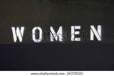 Women's bathroom door sign, Spray painted stencil letters - stock photo