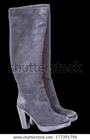 women's boots on black background