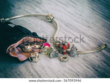 Women's Bracelet Pandora, Charms close-up, jewelry, vintage, retro style - stock photo