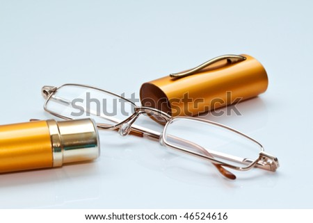 Women's glasses with yellow metal containers  close up