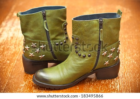 Women's green leather boots with asterisks. Cowboy style, vintage. - stock photo