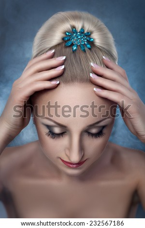 Women's hair gathered in bun and hairpin jewelry, the view from the top. - stock photo