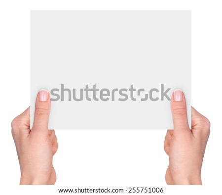Women's hands holding a blank business card isolated on white background  - stock photo