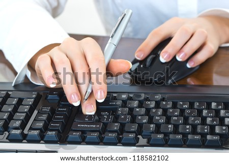 Women's hands on a computer keyboard - stock photo