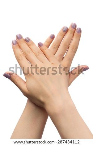 Women's hands, purple manicure with rhinestones. Isolate on white. - stock photo