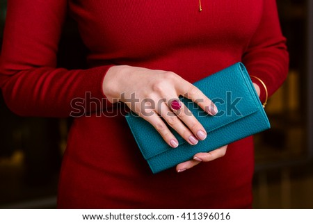Women's hands with a nice manicure Hold  wallet, closeup.  - stock photo