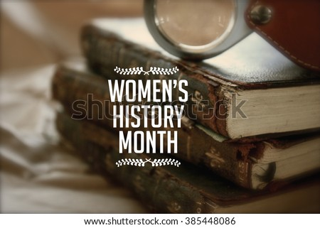 Women's history month photo with antique books. - stock photo