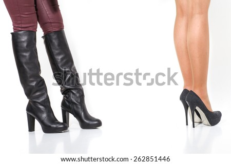 Women's leather boots with heels and shoes - stock photo