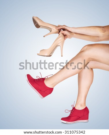 Women's legs with casual and classic design shoes - stock photo