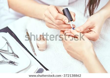 Women's manicure, Nail Polish, Hand Care - stock photo