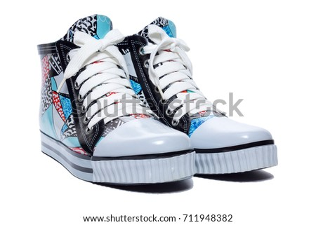 Women's rubber shoes on laces, isolated, studio