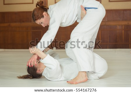 Women's section of Jiu Jitsu. Girls work out the reception.