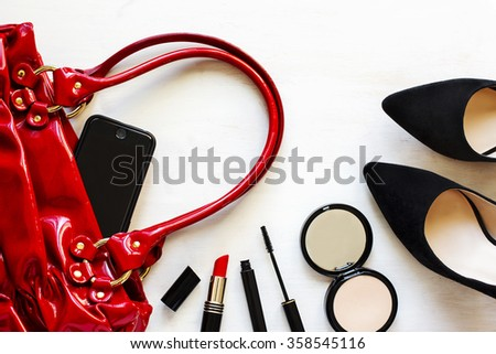 Women's set of fashion accessories on wooden background: shoes,  - stock photo