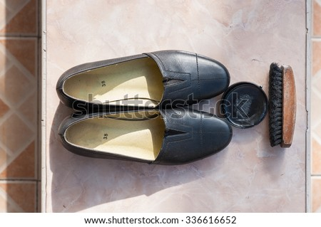 Women's Shoe with shoe brush and shoe polish - stock photo