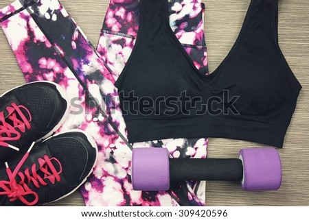Women's sport wear and Dumbbell. Fitness wear and equipment. Sport fashion, Sport accessories, Sport equipment. (Vintage Style Color) - stock photo