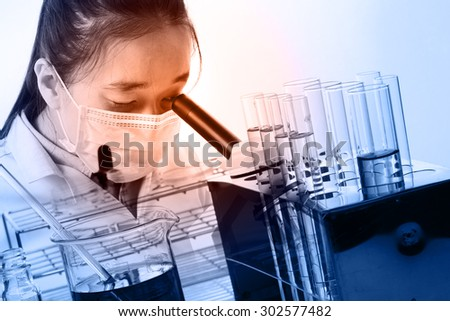 Women Scientist is using microscope in analytically laboratories. - stock photo