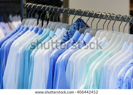 Women shirts blouses on a clothes rack