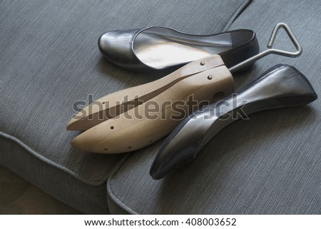 women shoes with shoe stretcher - stock photo