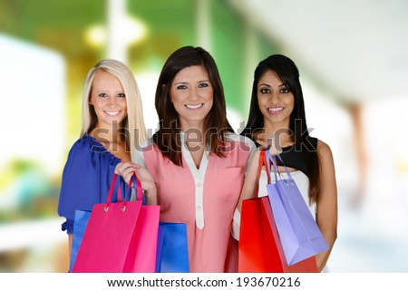 Women shopping with bags at the mall - stock photo