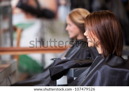 Women sitting in beauty salon. - stock photo