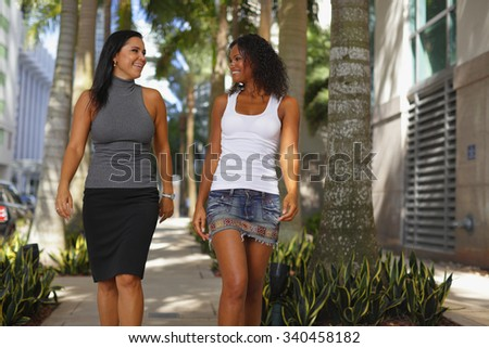 Women smiling and walking - stock photo