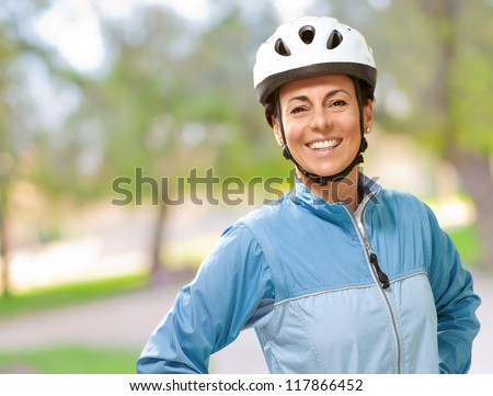 Women smiling with hands on hip, outdoor - stock photo