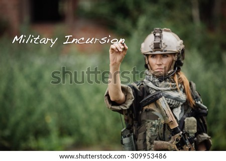 women soldiers Hand writing military incursion - stock photo