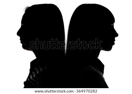 Women standing back to back on white background