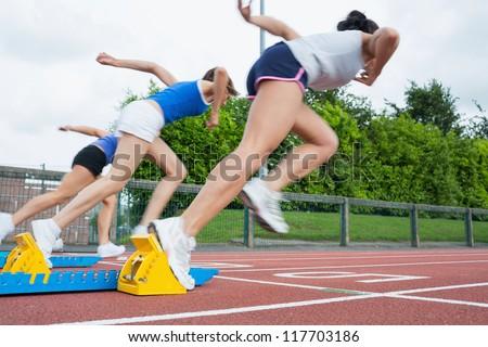 Women starting the race in the stadium - stock photo