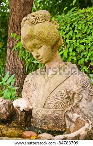 women statue in garden - stock photo