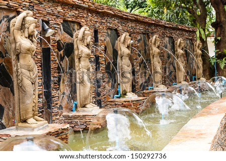 Women statue in the park - stock photo