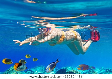 Women underwater in Aegean Sea of Greece - stock photo