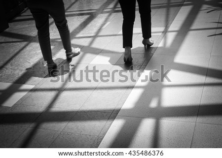 Women walking along the footway - Concept background - Black and White - stock photo