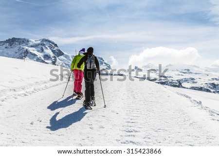 Women walking on ski in the snow mountain.