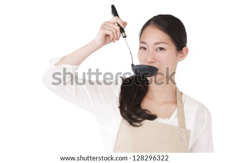 Women who have a taste in the ladle - stock photo