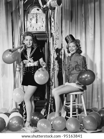 Women with balloons on New Years Eve - stock photo