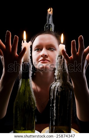Women with candles on a black background.