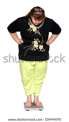 women with overweight looking on scales isolated on white - stock photo