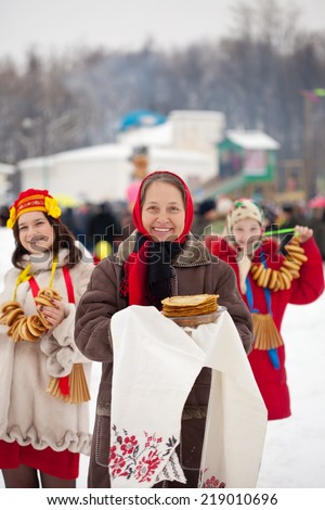 Women with pancakes during  Shrovetide in Russia