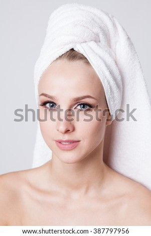 Women with perfect skin and towel on her head