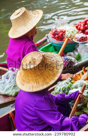 women with traditional hats on a floating market in Bangkok, Thailand - stock photo