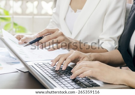 women working during a business meeting