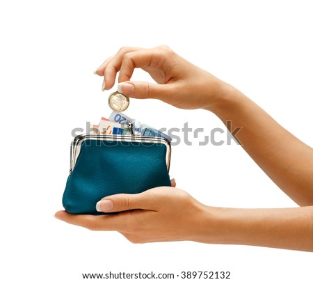Womens hand throwing a coin one euro in the full purse on white background. Business concept - stock photo
